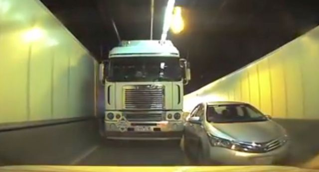 Crash in a Sydney tunnel on-ramp as truck driver refuses to let in merging car