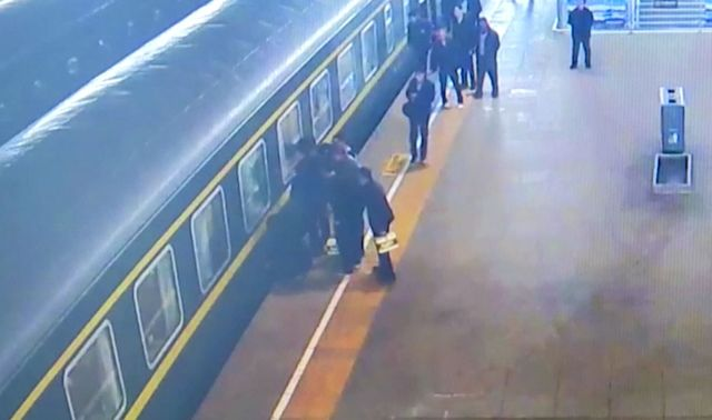 Video shows toddler's dramatic rescue after falling between platform and train