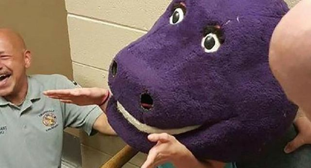 Teenager gets stuck inside giant Barney head for AN HOUR after trying to scare her friends