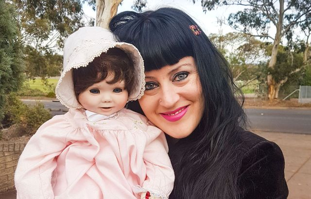 Mum says her collection of 'possessed' antique baby dolls lets her talk to the dead